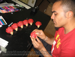 Mezco Sales Coordinator  and Thundercats expert Pierre Kalenzaga checks quality of Lion-O heads.